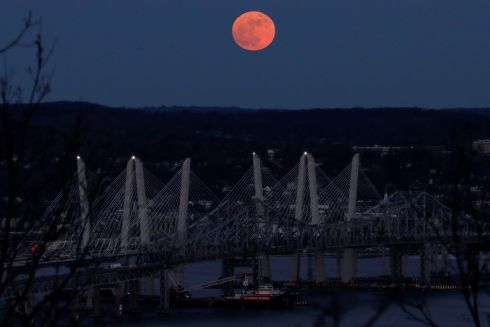 A 'supermoon' full moon is seen above the Hudson River and the Mario M. Cuomo Bridge from Nyack, New York.   Photograph: Mike Segar / Reuters