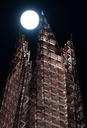 The first supermoon of 2018 in the sky above the Shard in London.   Photograph: John Stillwell/PA