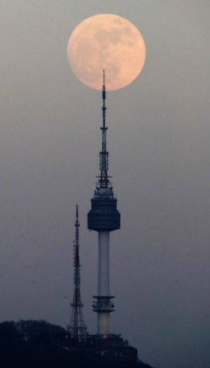 A supermoon rises over the N Seoul Tower on Mount Nam one of the top tourist spots in Seoul, South Korea. Photograph:  Yonhap / EPA
