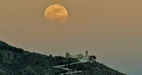 View of first full moon of 2018 over the Castle of Cullera, Valencia, eastern Spain. Photograph: Manuel Bruque / EPA