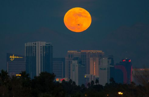 The first supermoon of the new year rises above the Vegas Strip. Photograph: Richard Brian/Las Vegas Review-Journal via AP
