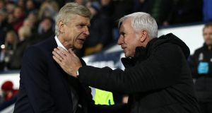 The Premier League's longest-serving manager Arsene Wenger, and one of the shortest, Alan Pardew. Photograph: Jan Kruger/Getty
