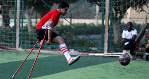 "Mahmoud Tawfik (28), captain of ""Miracle Team"", during a training session at El Salam club, Cairo. Photograph: Reuters"