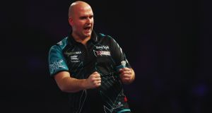 Rob Cross celebrates winning a set during the final of the PDC World Darts Championships  against Phil Taylor  at Alexandra Palace  in London. Photograph:  Naomi Baker/Getty Images