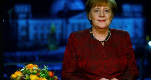 Germany's acting chancellor Angela Merkel after the television recording of her annual new year's speech. Photograph: Hannibal Hanschke/Pool photo
