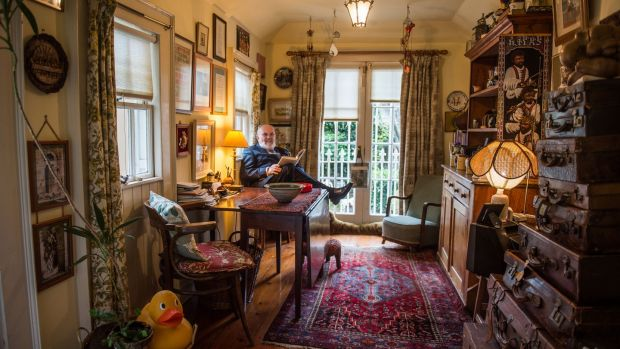 David Norris admits that his charmingly cluttered walls boast 17 painted portraits of him. Photograph: Ruth Medjber
