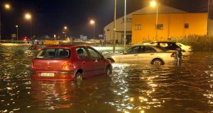 Cars in the flooded car park near the Galway Atlantaquaria in Salthill during Storm Eleanor. Photograph: Joe O'Shaughnessy