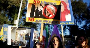 Opponents of Iranian president Hassan Rouhani hold a protest outside the Iranian embassy in Rome, Italy. Photograph: Tony Gentile/Reuters