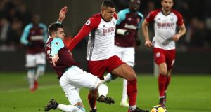 West Brom midfielder Jake Livemore is tackled by West Ham's Aaron Cresswell during his side's 2-1 defeat. Photograph: Catherine Ivill/Getty