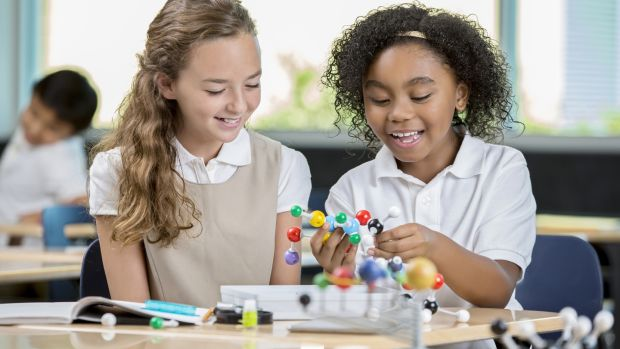 Students learning about molecular structure in science class. Get involved in your child's schoolwork – not only will it help you identify your child's development potential, but it will also give you an insight into their curriculum.