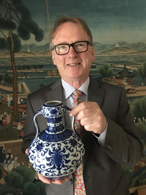 Auctioneer Michael Sheppard holding the antique Chinese porcelain vase that sold for €740,000 – the highest price ever paid for a piece of decorative art at auction in Ireland