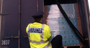 A garda searching a heavy goods vehicle at a checkpoint on the Cavan/Fermanagh Border. Photograph: Eric Luke