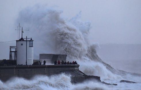 Large waves and high winds define Eleanor as they hit the lighthouse and seawall at Porthcawl in south Wales, Britain. Photograph: Reuters