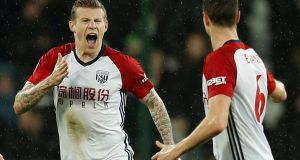 James McClean celebrates scoring his first goal in 15 months for West Brom, with team-mate Jonny Evans. The match ended in a 2-1 defeat against West Ham. Photograph: Eddie Keogh/Reuters