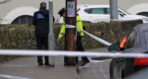 Gardaí examine a sealed-off scene at Seatown, Dundalk, Co Louth, near the scene of a fatal attack on Avenue Road on Wednesday morning. Photograph: Colin Keegan, Collins