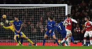 Hector Bellerin scores a late equaliser for Arsenal in the Premier League game against Chelsea at the Emirates Stadium. Photograph: Dylan Martinez/Reuters