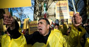 Dozens of protesters demonstrate against the Iranian regime and in support of the Iranian anti government demonstrators near the Iranian embassy in Paris, France. Photograph: Etienne Laurent/EPA