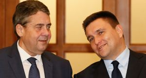 "German foreign minister Sigmar Gabriel  with  Ukrainian counterpart Pavlo Klimkin  in Kiev on Thursday. ""I hope we will manage to adopt a realistic and suitable mandate for a UN mission before the elections in Russia,"" said Mr Gabriel.  Photograph:  Gleb Garanich/Reuters"