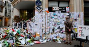 A makeshift memorial near the headquarters of the French satirical weekly 'Charlie Hebdo' in Paris in January 2015  in tribute to the 17 victims of a three-day killing spree by Islamist terrorists. Photograph: Bertrand Guay/AFP/Getty Images