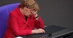 Germany's chancellor Angela Merkel: the refugee question, which she  sprang on her own people two years ago, has come back to haunt her. Photograph: Krisztian Bocsi/Bloomberg