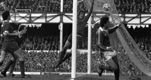 Everton's Imre Varadi wheels away in celebration after beating Liverpool goalkeeper Ray Clemence to put Everton 2-0 up in their 1981 FA Cup fourth round tie at Goodison Park. Photograph: Bob Thomas/Getty Images