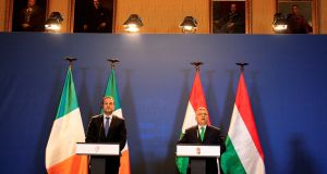 Taoiseach Leo Varadkar and Hungary's prime minister Viktor Orban hold a joint news conference in Budapest, Hungary, on Thursday. Photograph: Bernadett Szabo/Reuters