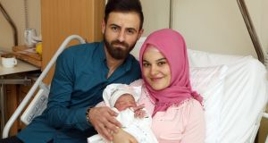 Naime and Alper Tamga with their daughter Asel, who was the first baby to be born in Vienna in 2018. Photograph: KAV/Votava