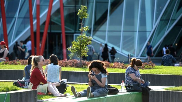 Enjoying the early evening weather last summer around the Grand Canal Square area in Dublin. Photograph: Dara Mac Dónaill/The Irish Times
