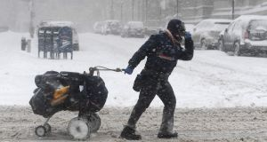 A giant winter 'bomb cyclone' walloped the US on Thursday with freezing cold and heavy snow, forcing thousands of flight cancellations and widespread school closures. Photograph: Angela Weiss/AFP/Getty Images