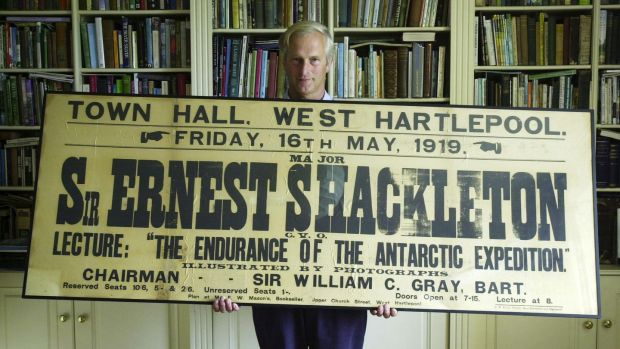 Jonathan Shackleton, second cousin of Sir Ernest Shackleton, with one of his personal pieces of memorabilia, a poster for a lecture by the explorer. Photograph: Frank Miller