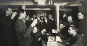 Members of the Imperial Trans-Antarctic Expedition  1914-17, led by Ernest Shackleton, drink a toast to 'sweethearts and wives' on board the Endurance. Photograph: Frank Hurley/Scott Polar Research Institute, University of Cambridge/Getty Images