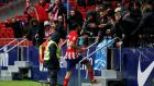 Atletico Madrid's Diego Costa celebrates scoring their second goal with fans before being sent off during the La Liga clash with Getafe. Photo: Javier Barbancho/Reuters