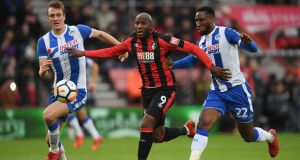 Dan Burn and Cheyenne Dunkley of Wigan Athletic challenge Bournemouth's Benik Afobe at the Vitality Stadium. Photograph: Mike Hewitt/Getty Images
