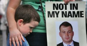 An image of murdered PSNI constable Ronan Kerr is held during a rally for peace held in Omagh on April 10th, 2011. Photograph: The Irish Times