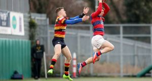 Lansdowne's Adam Leavy outjumps James McKeown of Clontarf. Photo: Oisin Keniry/Inpho