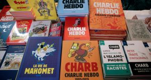Books on display at an event at Folies Bergère theatre to mark the third anniversary of the Charlie Hebdo attack. Photograph: Yoan Valat/EPA