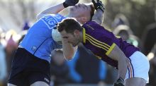 Wexford's Brian Malone and Paddy Small of Dublin compete for the ball. Photograph: Bryan Keane/Inpho