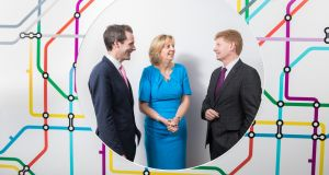 Shane MacSweeney, Annette Hughes  and Mike McKerr: acquisition of DKM is in line with EY's global and Irish strategy to integrate the full range of economic advisory services. Photograph:  Naoise Culhane