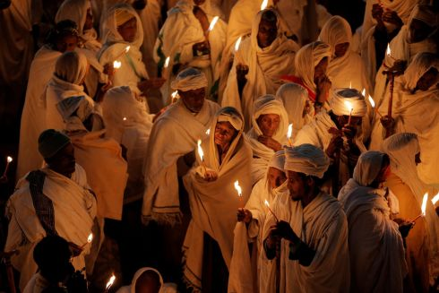 Ethiopian Orthodox pilgrims attend Christmas Eve celebration in Bete Mariam (House of Mary) monolithic Orthodox church in Lalibela, Ethiopia. Photograph: Reuters