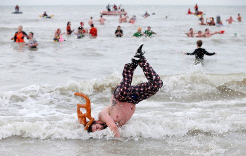 A participant jumps in the waters of the North Sea during the annual New Year's plunge event in Ostend, Belgium. Photograph: Reuters