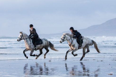 Emily Kelly (14) and Megan O'Malley (14)  both from Westport, enjoying the last day of the winter school holidays on their Connemara ponies at Carrowniskey Strand, Co Mayo. Photograph: Naoise Culhane