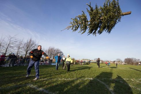 Overall winner Johnny Leahy, Lissycasey, taking part in the seventh annual Christmas Tree throwing Championships in Ennis, Co Clare. Photograph by Eamon Ward