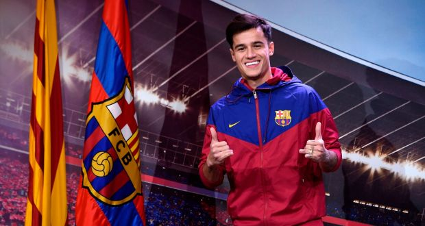 a7623dbdc0d Barcelona s new Brazilian midfielder poses for a picture with a Catalan  flag and a Barcelona flag