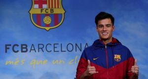 "Barcelona present new signing   Philippe Coutinho. ""If Liverpool were prepared to pay their best players more than €20 million a year, as Barcelona and Real Madrid do, then they would find their stars suddenly become resistant to the lure."" Photograph: Albert Gea/Reuters"