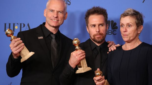 "Martin McDonagh (L), winner for Best Screenplay - Motion Picture, Sam Rockwell, winner for Best Performance By An Actor In A Supporting Role In Any Motion Picture, and Frances McDormand, winner for Best Performance By An Actress In A Motion Picture - Drama, pose backstage after also winning the award for Best Motion Picture - Drama for ""Three Billboards Outside Ebbing, Missouri."" Photograph: Lucy Nicholson/Retuers"