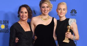 Hollywood's women take part in Golden Globes blackout protest