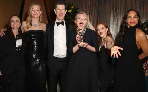 Elisabeth Moss, who won best actress in a TV series fro the Handmaid's Tale, with (from left) Alexis Bledel, Yvonne Strahovski,  Craig Erwich,  Madeline Brewer and Amanda Brugel at the FOX, FX and Hulu after party  at The Beverly Hilton Hotel. Photograph: Rachel Murray/Getty Images