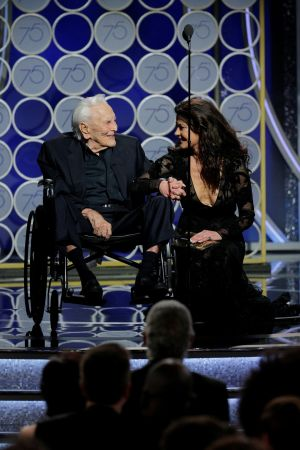 Kirk Douglas at the age of 101 on stage at the Golden Globes with Catherine Zeta Jones. Photograph: Reuters