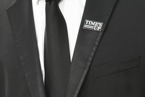 An attendee wearing a 'Times Up' badge at the Golden Globes. Photograph: Valerie Macon/AFP/Getty Images