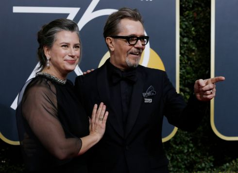 Gary Oldman and Gisele Schmidt arrive for the the 75th Golden Globes. Photograph: Mario Anzuoni/Reuters